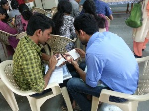 Derin and Jibit of Jesus Youth discover CCO's Ultimate Relationship booklet.